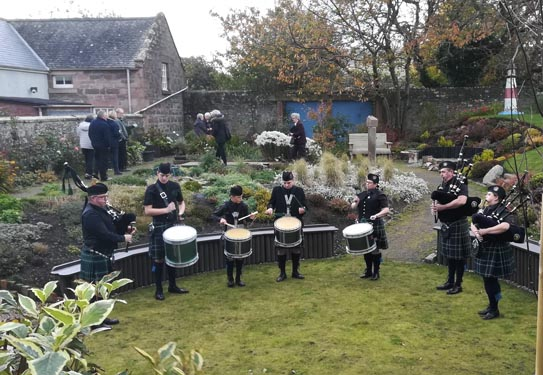 The Mearns Pipe Band in the Vaoyage of Life Garden